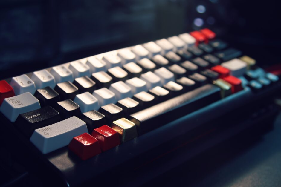 white and red wireless computer keyboard